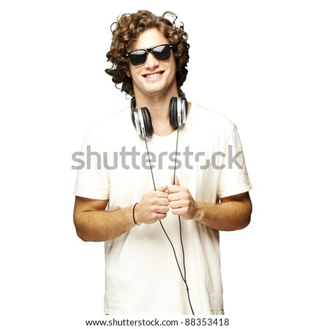 portrait of young man smiling with headphones over white background - stock photo