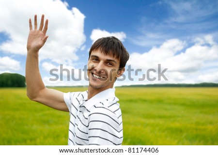 Portrait of young man taking energy from nature on vacation at countryside - stock photo