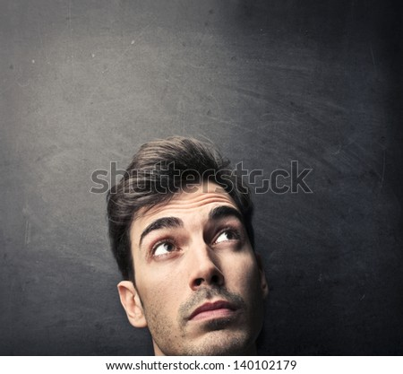 portrait of young man thinking - stock photo