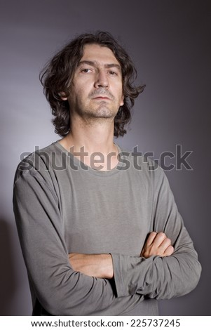 Portrait of young man thinking on a black background - stock photo