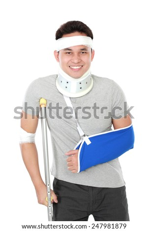 portrait of young man wear sling arm and crutch - stock photo