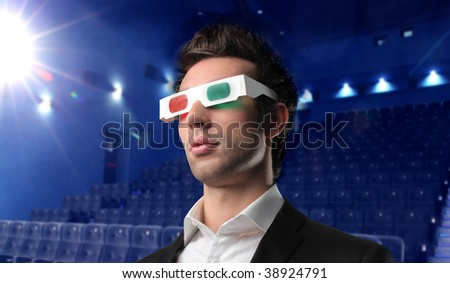 portrait of young man wearing 3d glasses in a cinema - stock photo