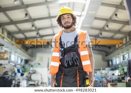 Portrait of young man wearing protective clothing in metal industry