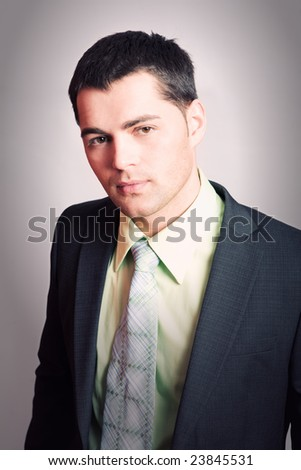 Portrait of Young man wearing suit with tie - stock photo