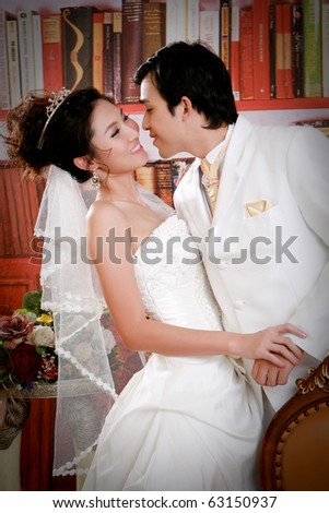 Portrait of young man willing to kiss his bride - stock photo