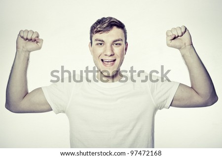portrait of young man winner - stock photo