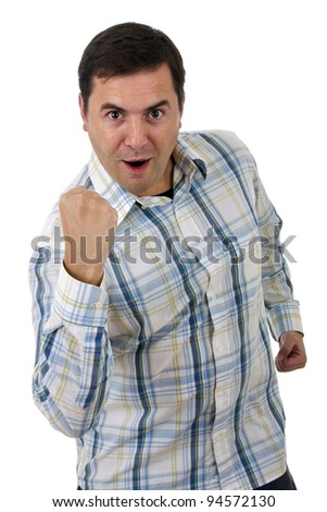 portrait of young man winner gesture against a white background - stock photo
