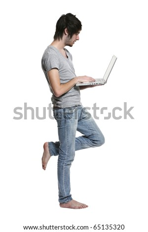 Portrait of young man with a computer on  white background - stock photo
