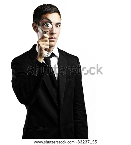 portrait of young man with a magnifying glass on white background - stock photo