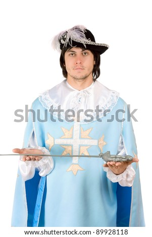 Portrait of young man with a sword dressed as musketeer - stock photo