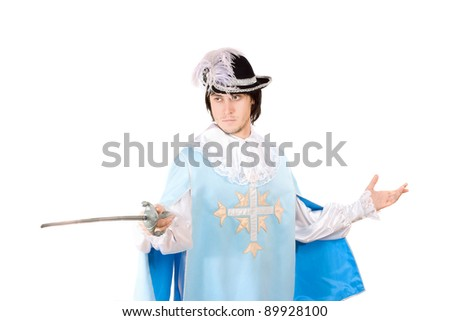 Portrait of young man with a sword dressed as musketeer. Isolated - stock photo
