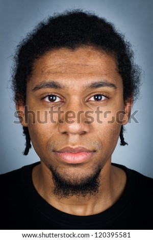 Portrait of young man with emotional facial expression - sad man - stock photo