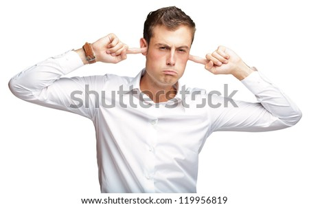 Portrait Of Young Man With Finger In His Ear On White Background - stock photo