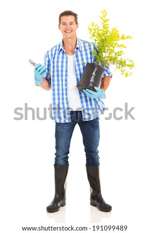 portrait of young man with gardening tool and plant isolated on white - stock photo
