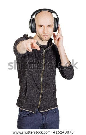 portrait of young man with headphones listening music and dancing. image isolated white background