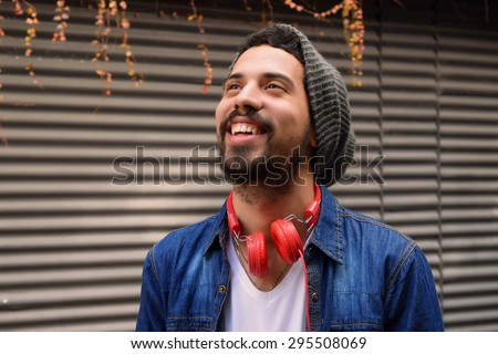 Portrait of young man with red headphones. - stock photo