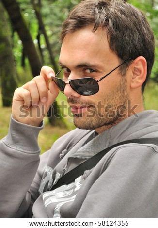 portrait of young man with sunglasses - stock photo