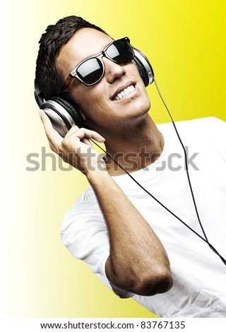 portrait of young man with sunglasses playing to music on a white background - stock photo