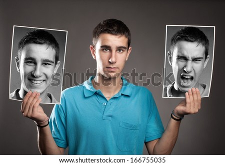 portrait of young man with two faces - stock photo