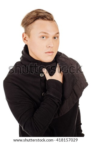 Portrait of young man with very handsome face in casual wear against white studio background