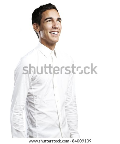 portrait of young man with white shirt smiling against a white background - stock photo