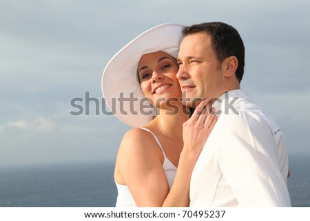 Portrait of young married couple - stock photo