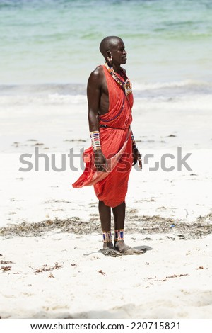 Portrait of young Masai man on beach with narrow focus - stock photo