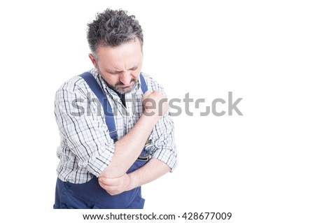 Portrait of young mechanic having pain in injured arm or elbow with advertising area isolated on white background