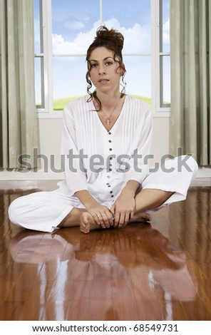 portrait of young meditating woman in domestic environment