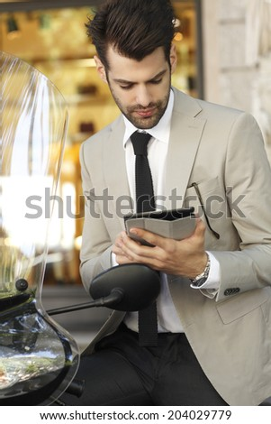 Portrait of young modern businessman using digital tablet.  - stock photo