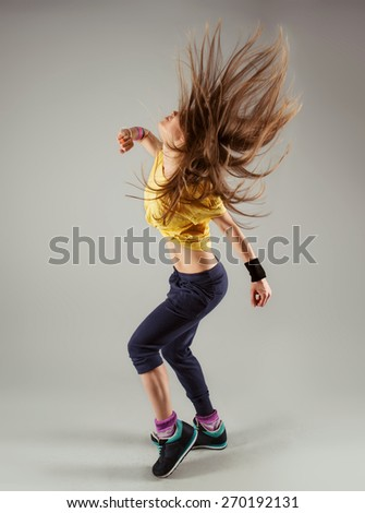 Portrait of young modern girl dancing hip hop in dance studio. Sport, health and leisure.  - stock photo