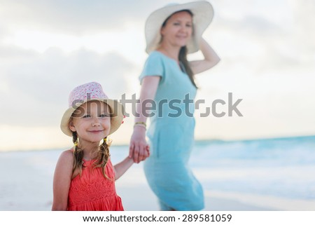 Portrait of young mother and her adorable little daughter on vacation - stock photo