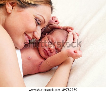 Portrait of young mother and newborn son - stock photo