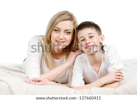 portrait of young mother and son on white