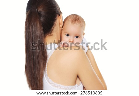 Portrait of young mother holding on hands baby - stock photo