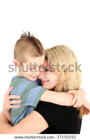 Portrait of young mother hugging son, studio shot