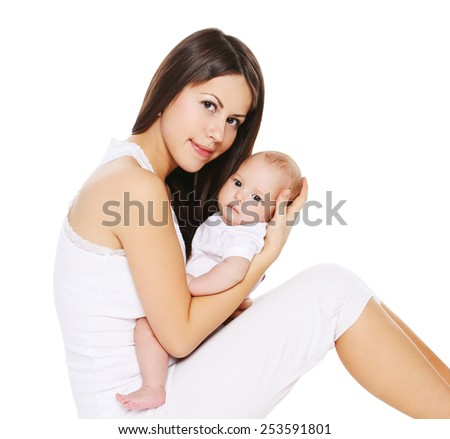 Portrait of young mother with her infant on hands - stock photo