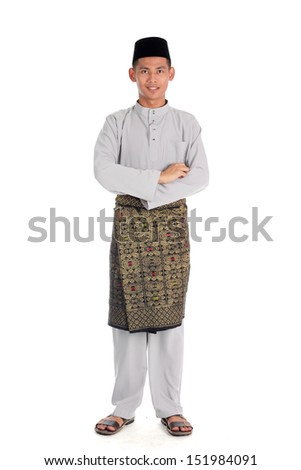 Portrait of young muslim with malaysia traditional baju melayu isolated on white - stock photo