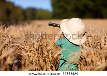 Portrait of young nature explorer in wheat field - stock photo