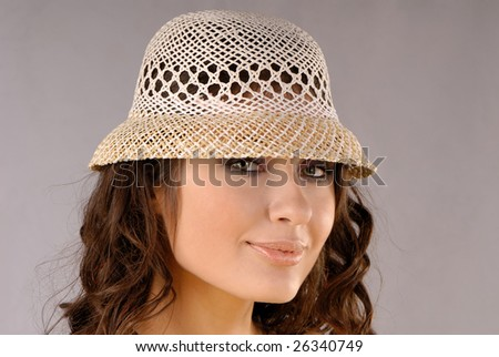 Portrait of  young nice girl isolated on  white background in  hat