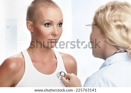 Portrait of young nice woman on medical examination - stock photo