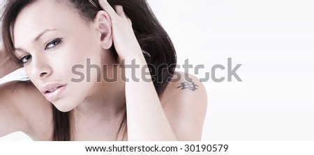 portrait of young nude brunette woman with tatoo - stock photo