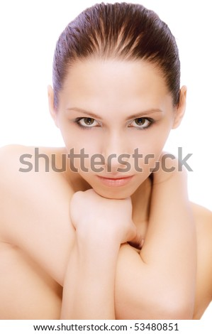 Portrait of young nude woman who lours, on white background.