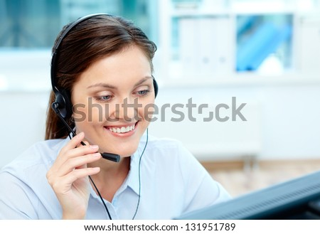 Portrait of young operator with headset consulting clients online