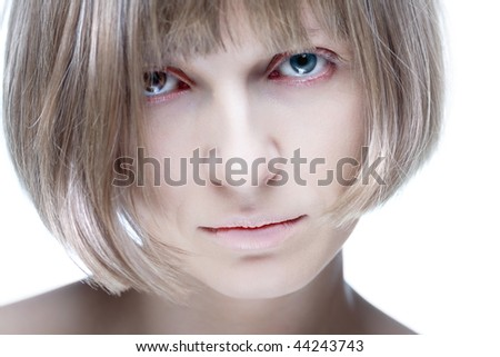 Portrait of young pale woman with eyes of different colors, isolated on white - stock photo