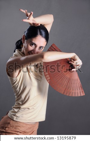 Portrait of young passionate flamenco dancer girl - stock photo