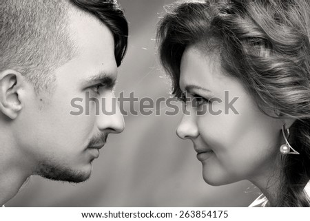 portrait of young people in love . look at each other - stock photo