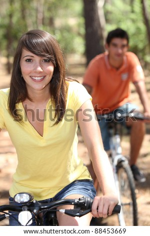 portrait of young people on bikes - stock photo