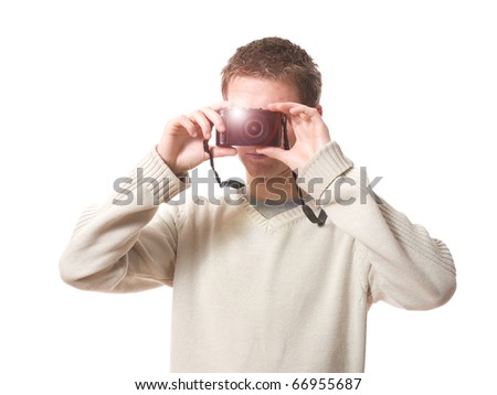 portrait of young photographer taking photo with compact camera isolated on white background - stock photo