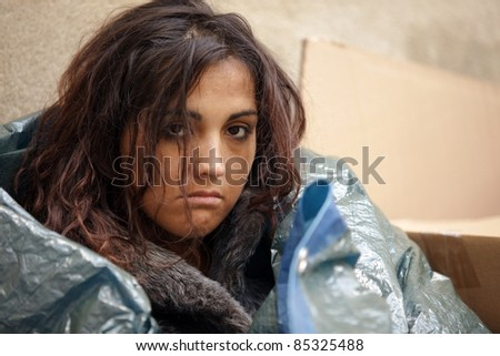 portrait of young poor woman in cold weather - stock photo